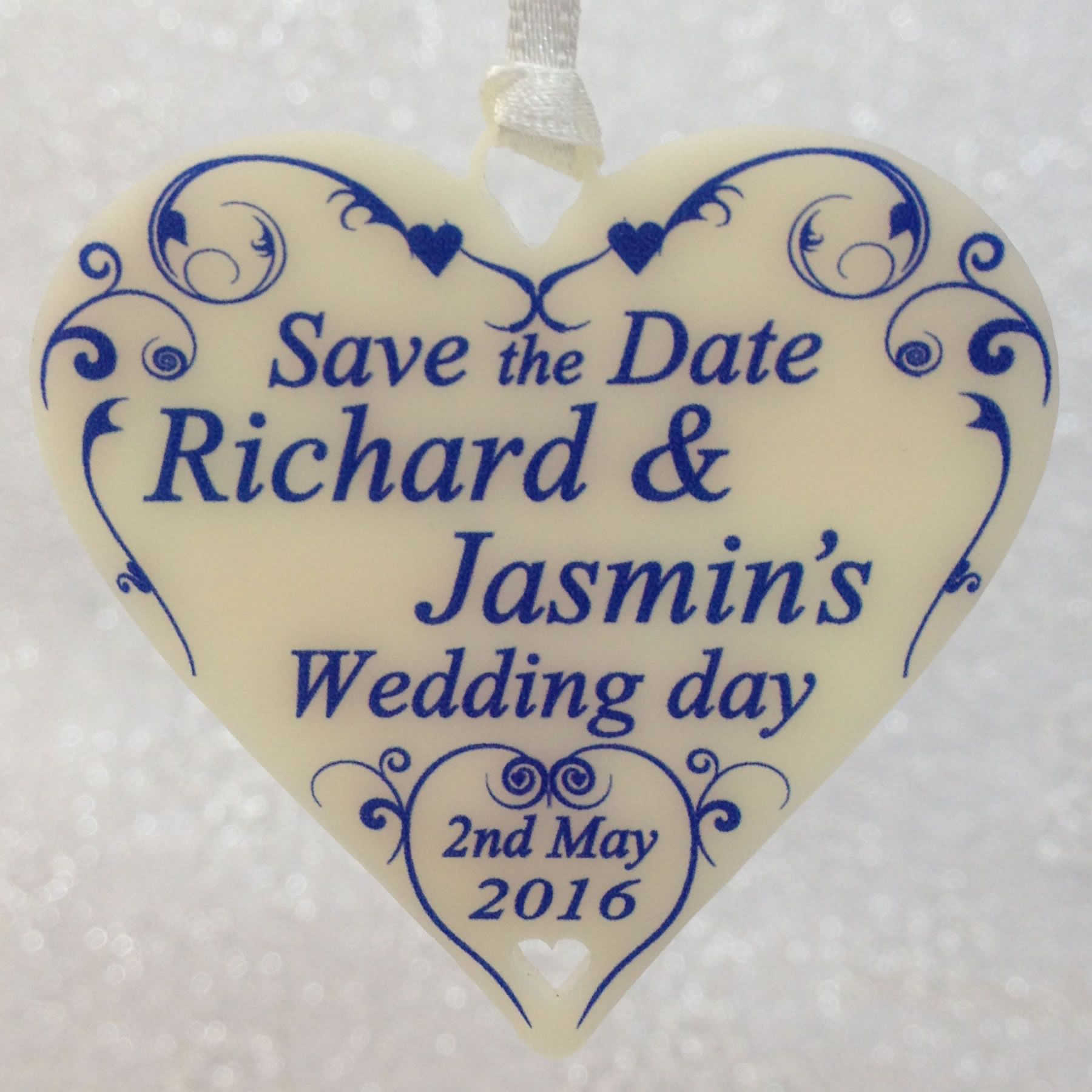 Save the date hearts, in cream with swirl heart and blue text.   Perfect for announcing your wedding date and a great keepsakes for you guests.  Personalise with any name and date of your choice.  ** Includes Organza Gift Bags, Ribbon & Envelopes **