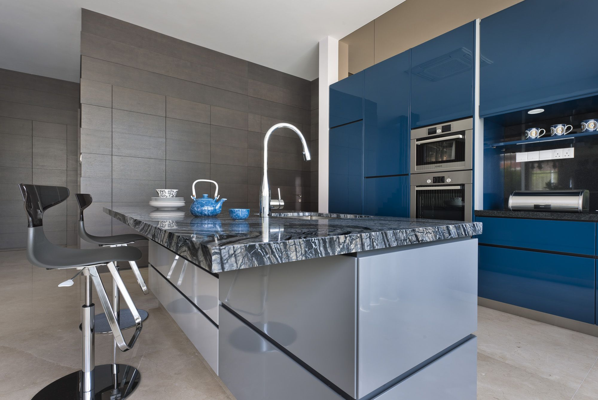 a beautiful blue ocean marble worktop and blue lacquered