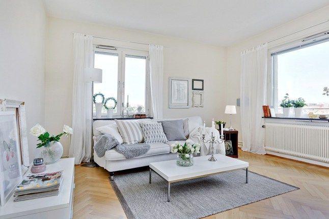 Un appartement blanc et noir et | Appartement blanc, Salon canapé et Couleurs de peinture pour salon
