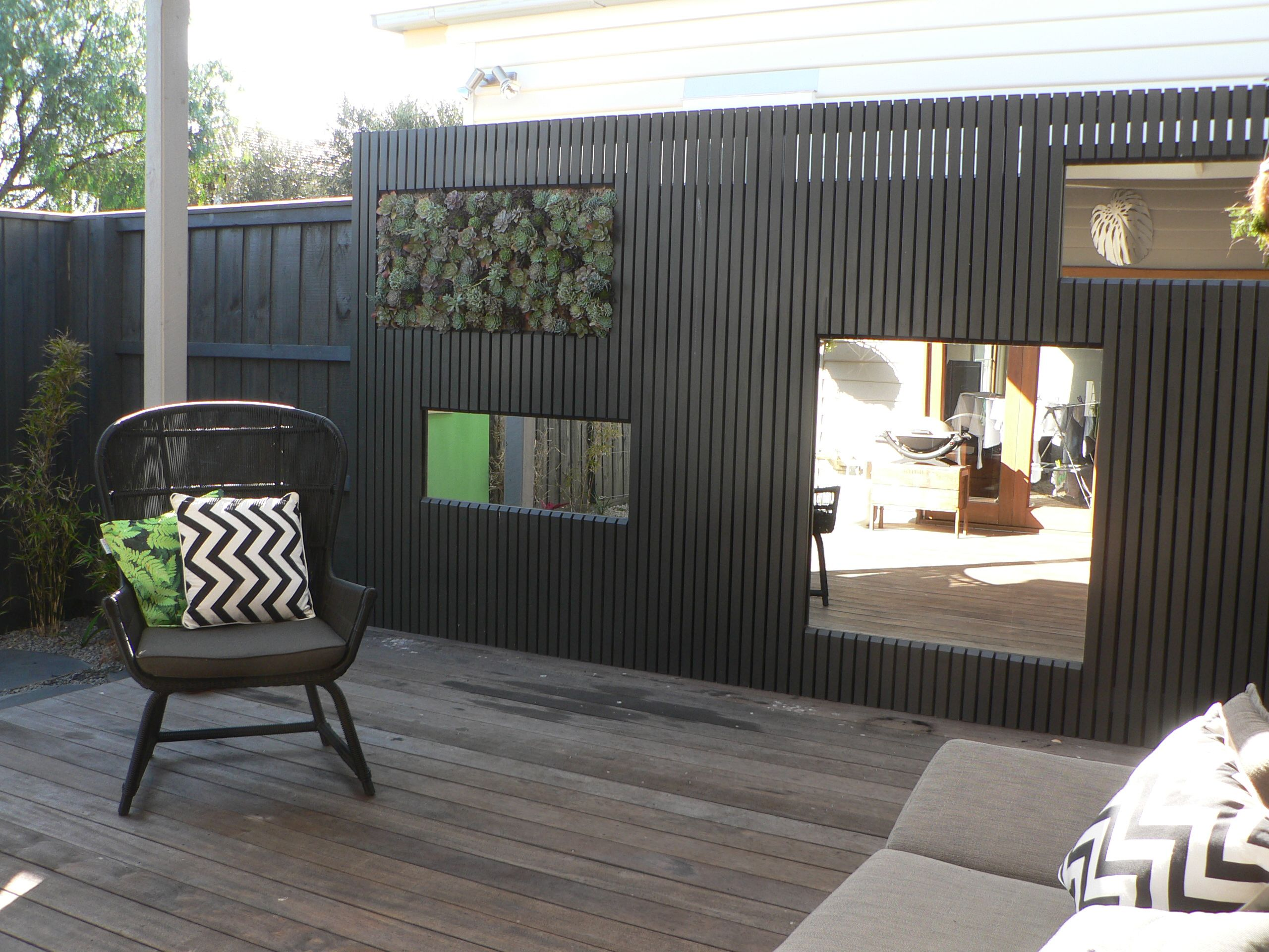 vertical succulent garden mirrors turn this side fence into a
