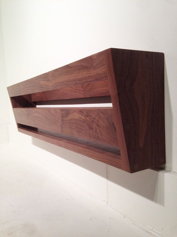 Modern Walnut Wall Mounted Shoe Rack. I could do a whole wall of these in the closet to free up lots of floor space.