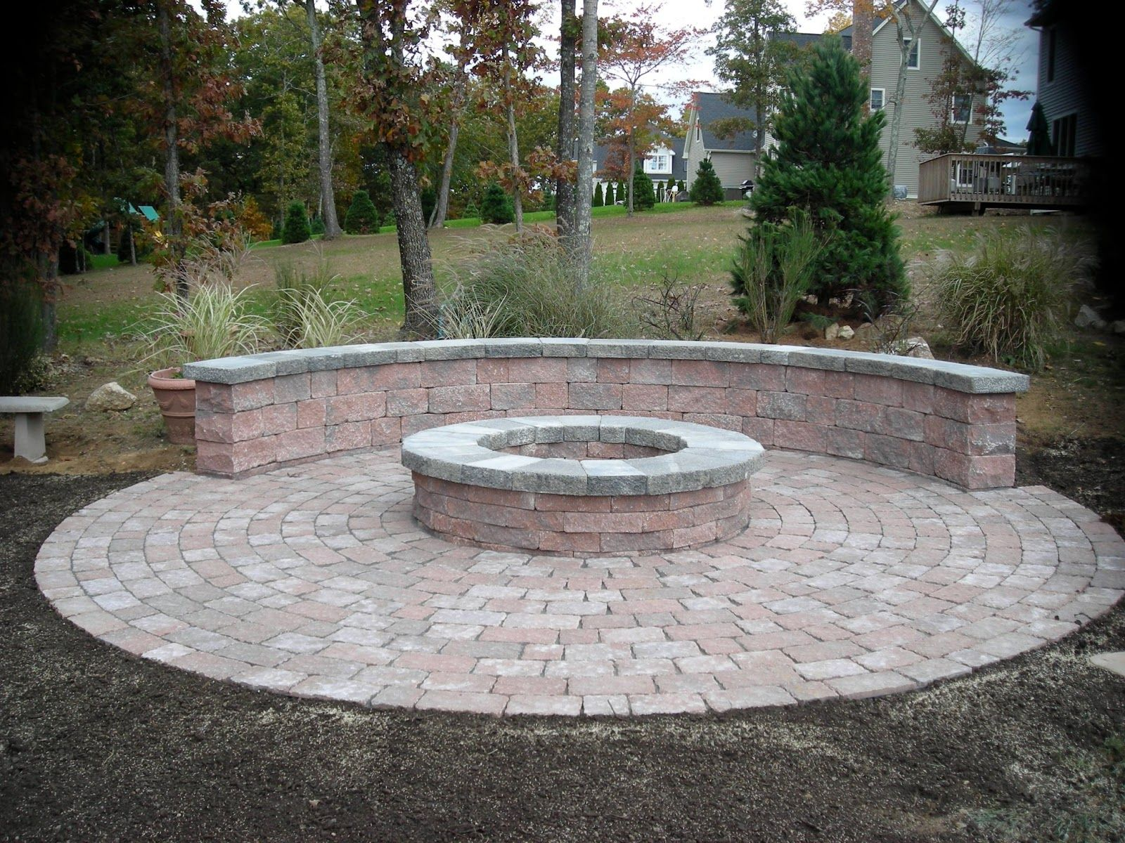 exterior very popular round fire pit with paver stone patio and