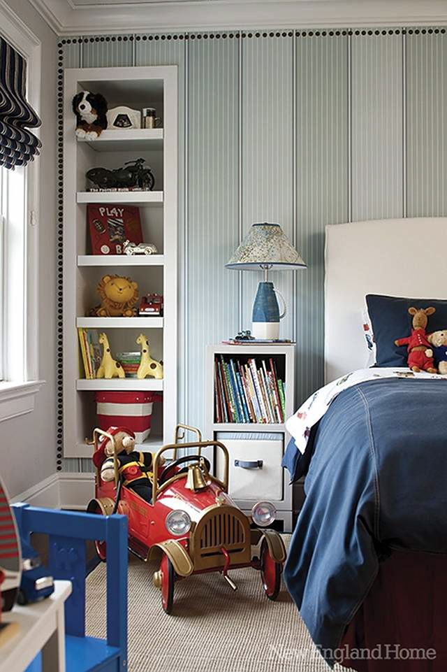 striped wall with nailhead trim + recessed bookcase + upholstered bed