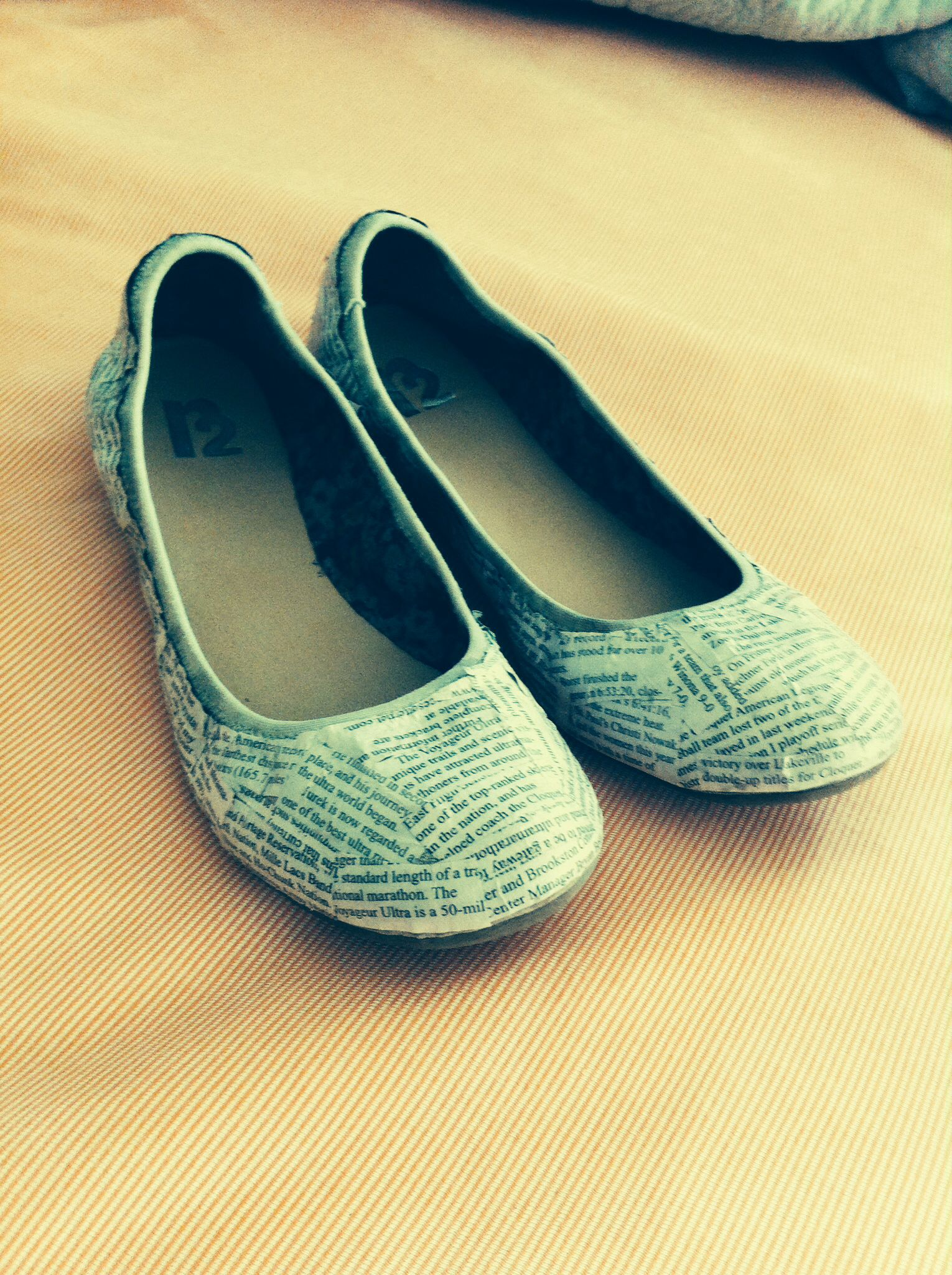 Saw this on Pinterest and decided to try it out.  Simply cover an old pair of flats using modge podge.  Super easy and super cute!