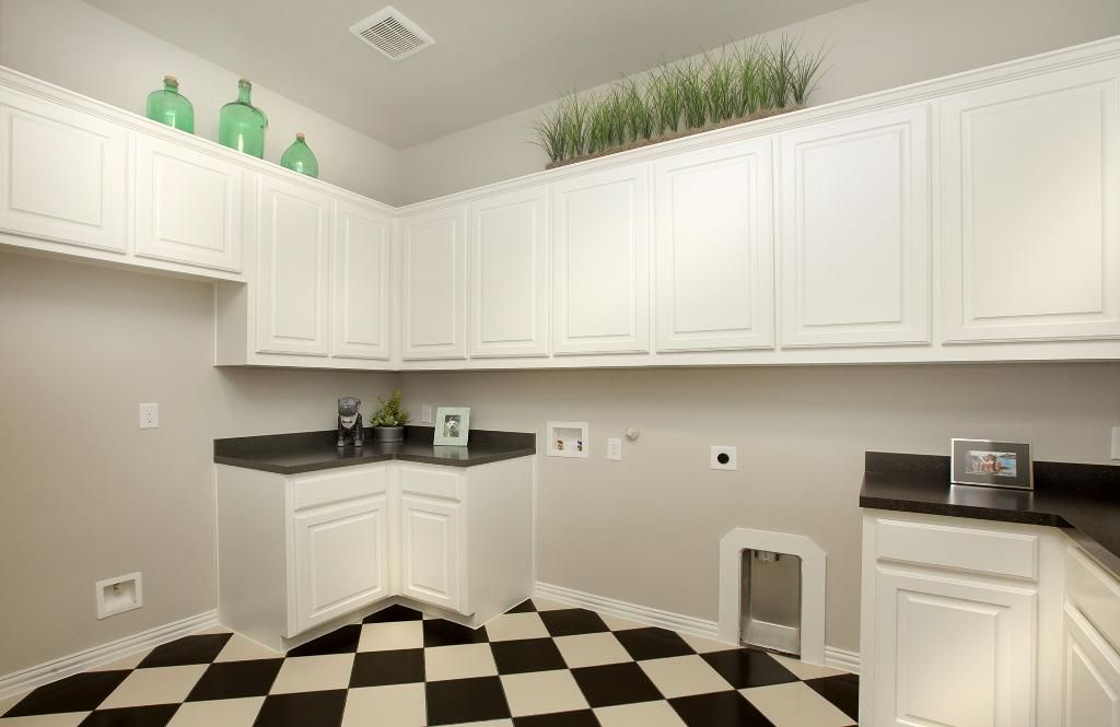 Laundry Room With White Cabinets And Black And White Checkered