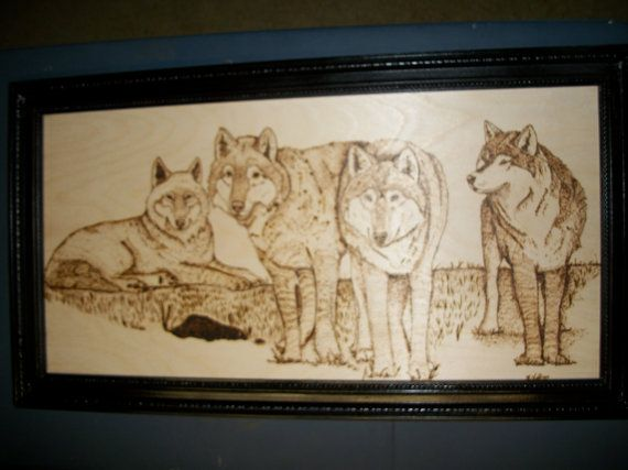 his is a woodburning of four wolves. It is burned on a birch panel and measures approximately 2.5 feet wide by 1.5 feet tall. This has been framed with a hand built frame and the portrait is affixed to the frame with nails. This piece took over 30 hours to complete. I stopped keeping track :)