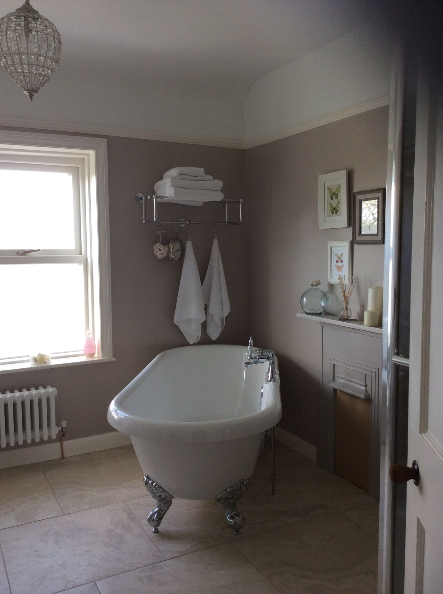 Roll top bath in modern bathroom with walls painted in