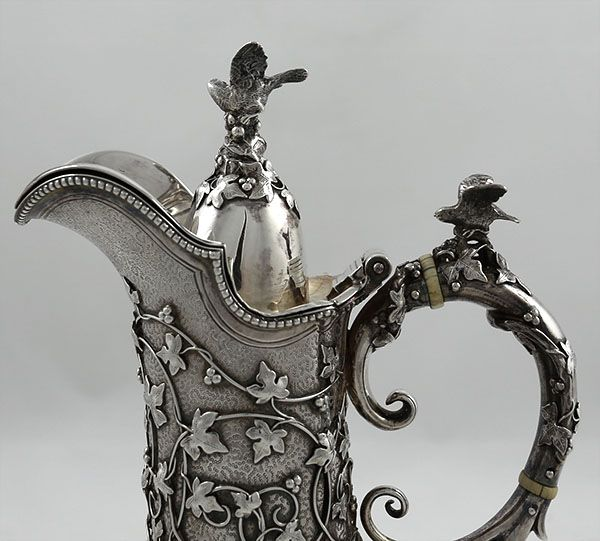 Fine antique silver chocolate pot by Tiffany and Company with applied cast vines and ivy with birds