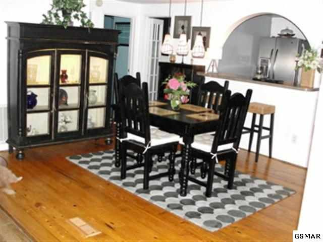 Beautiful, rustic, hardwood floors perfectly accent the 20 x 12.8 dining room.