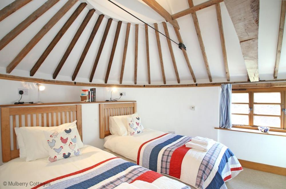 Beautiful Oast roundel ceiling and colourful touches - great combo! Mallingdown Farm, Holiday Cottage in Piltdown, Sussex