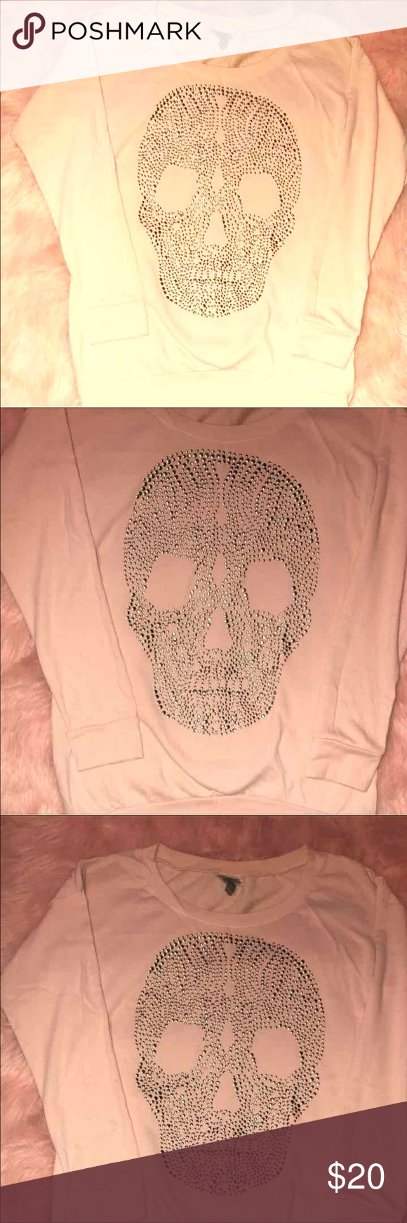 Size Large Cute sweater, light pink in color. Tunic like- long enough to wear w/leggings Sweaters