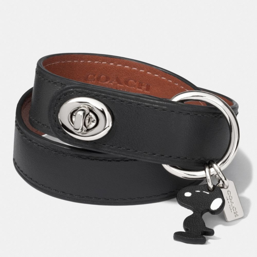 The Coach X Peanuts Leather Turnlock Bracelet from Coach