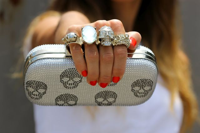 Alexander McQueen knuckle clutches.