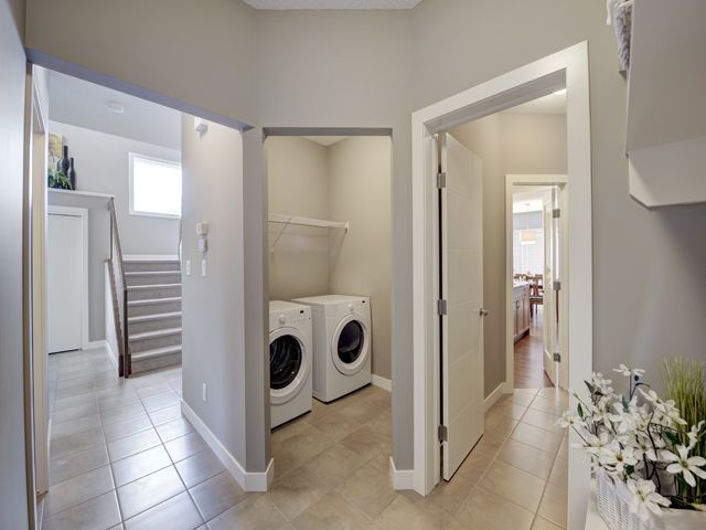 Garage entry into home has access to the main floor launry room, walk through pantry into the kitchen and front hallway, front door of the home. Mudroom also has a built in bench and cubbies set with coat hooks done in painted MDF.