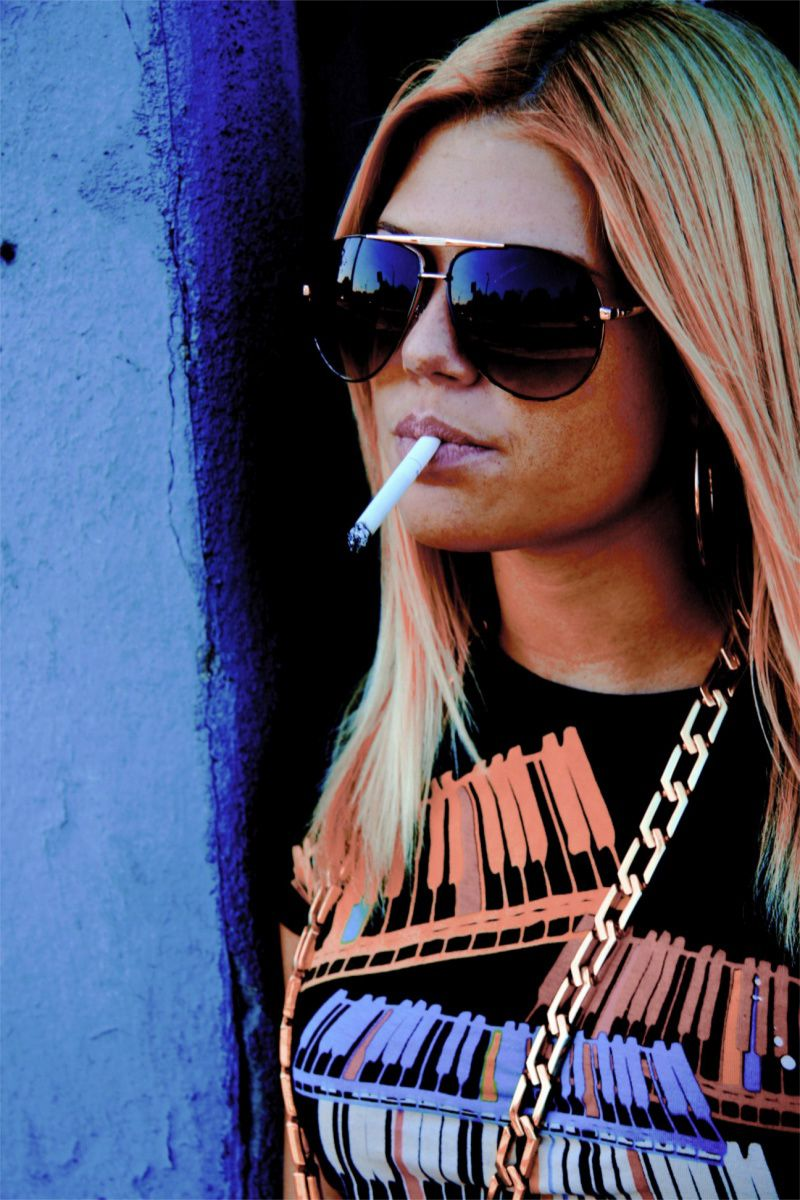 Chanel West Coast smoking a cigarette (or weed)