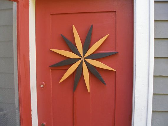 For your outdoor and indoor decorating this year consider my colorful wooden folk art style starburst wreath made from reclaimed pine wood. Options for placement are limitless!  The warm tones and friendly design will be a subtle and refreshing rustic decoration to enjoy throughout the year. Add color to an outdoor wall or lighten up your garden during the winter. Many people like to place their starburst art indoors as well to brighten a wall.  Laughing Creek colors included in this…