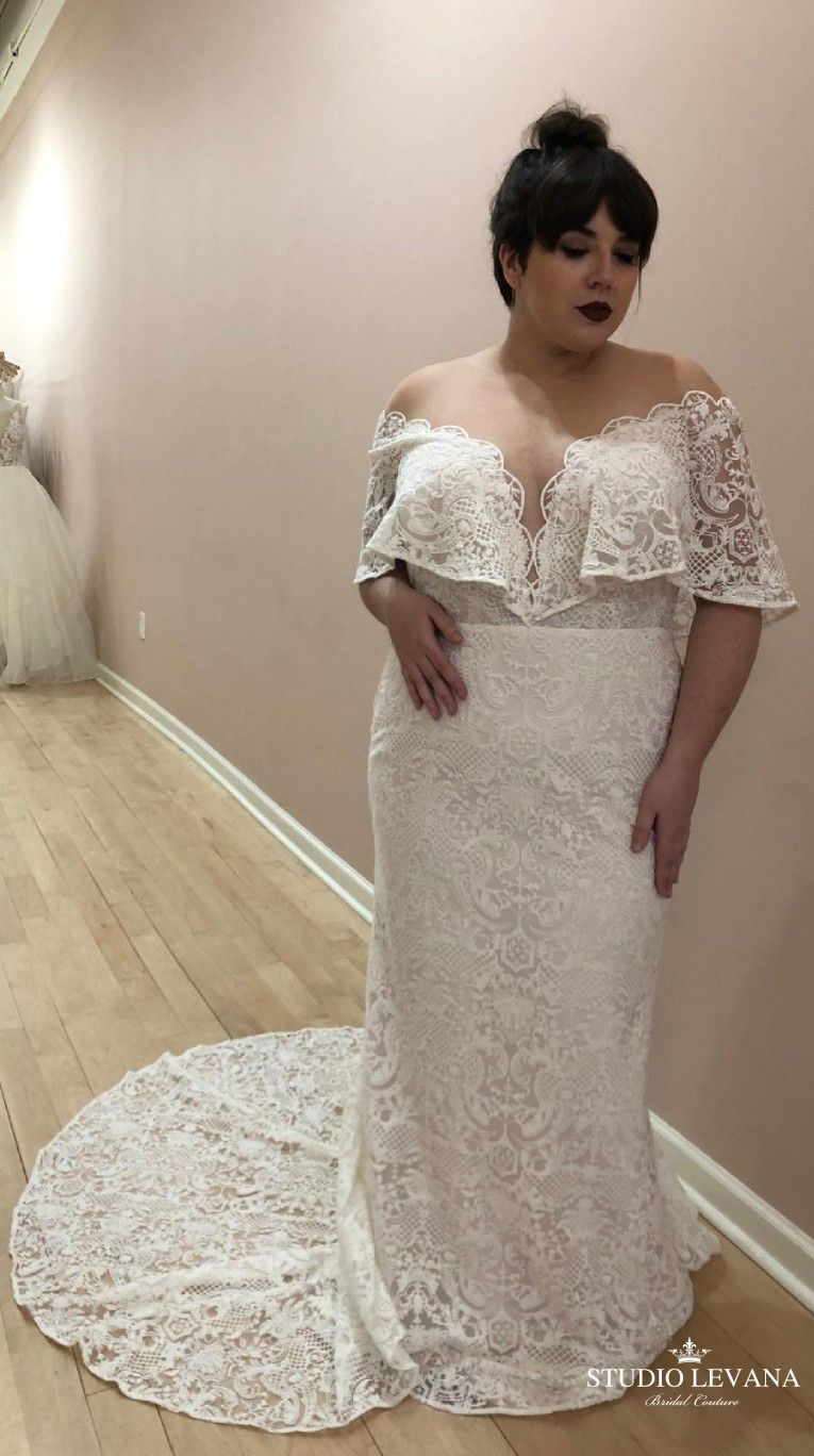 c95fdaffcb6e Curvy bride beautiful in a plus size mermaid boho wedding dress with deep v  neckline and geometric vintage lace. Featuring cape off shoulder sleeves.  Sean.