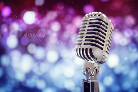 Vintage microphone on stage by BrianAJackson Retro singing microphone with stage lighting background