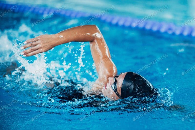 Professional swimmer, swimming race, indoor pool photo by microgen on Envato Elements | Exercice ...