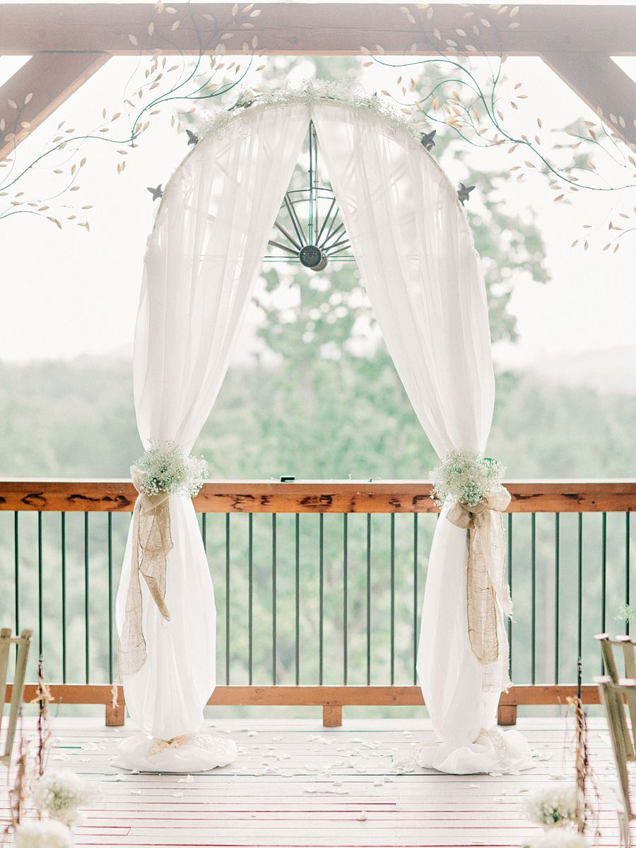 Wolf mountain vineyards wedding from amy arrington photography arch decorated with white hydrangeas babys breath wolf mountain vineyards wedding from junglespirit Choice Image