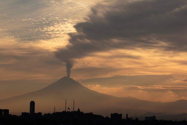 Puebla, Mexico: The Popocatépetl volcano spews a cloud of ash and steam high into the air