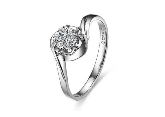 Flower Shaped 18K White Gold Engagement Ring with a natural 0.15ct Diamond gives this ring an extraordinary look. Stand out anywhere you go and show your engagement to that special someone in the way a woman is supposed to: beauty ! Your girlfriends will envy you !   This very elegant diamond ring will give you the ultimate satisfaction and feeling of love.   #beautiful #engagement #ring