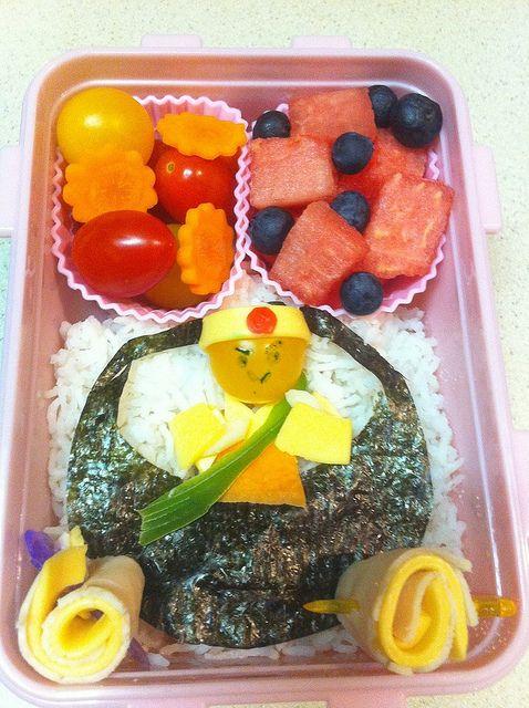 Rice Samurai man, tomatoes, carrots, watermelon and blueberries