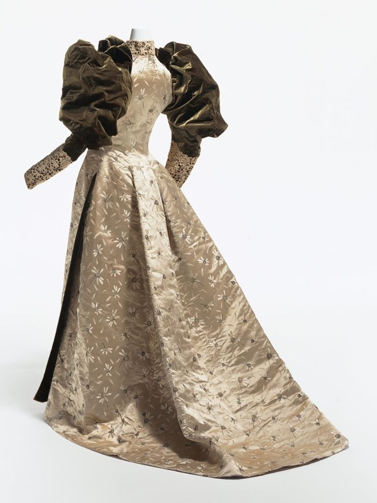 Reception Gown, House of Worth. Brocaded silk satin with silk velvet gigot sleeves. Ca. 1895.