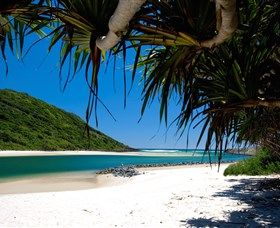 """Tallebudgera Creek : Ancient Aborigines used to call this Gold Coast suburb """"good fish"""" and you'll hear no argument from us on this apt name. For Tallebudgera is best known for its sparkling creek which is framed by the Burleigh Heads National Park on one side and..."""