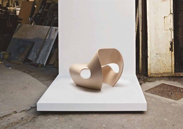 Architectural, The Brown Curvilinear Plain Chair: Cool Stylish Chair Design Inspired by the Concave Lines of Sea Shells