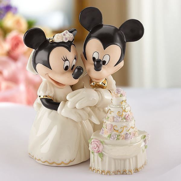 Minnie's Dream Wedding Cake Disney Wedding Cake Topper Figurine - Lenox. Finally, it's time for their first task together as mouse and wife... cutting the cake. Mickey is ever-so handsome in his morning coat with tails and a gold bow tie. Minnie wears a traditional ball gown. Bears the Lenox and Disney names in 24 karat gold.  $94.95
