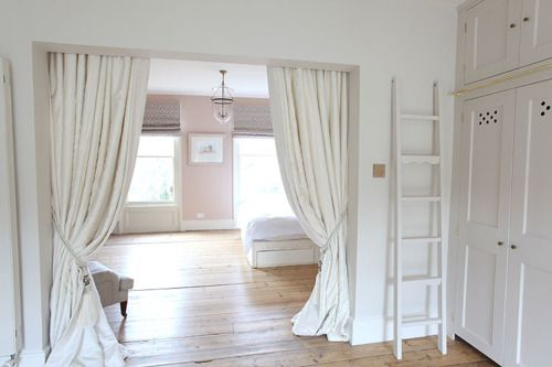 Use drapery to separate rooms, adding softness with a sense of privacy.