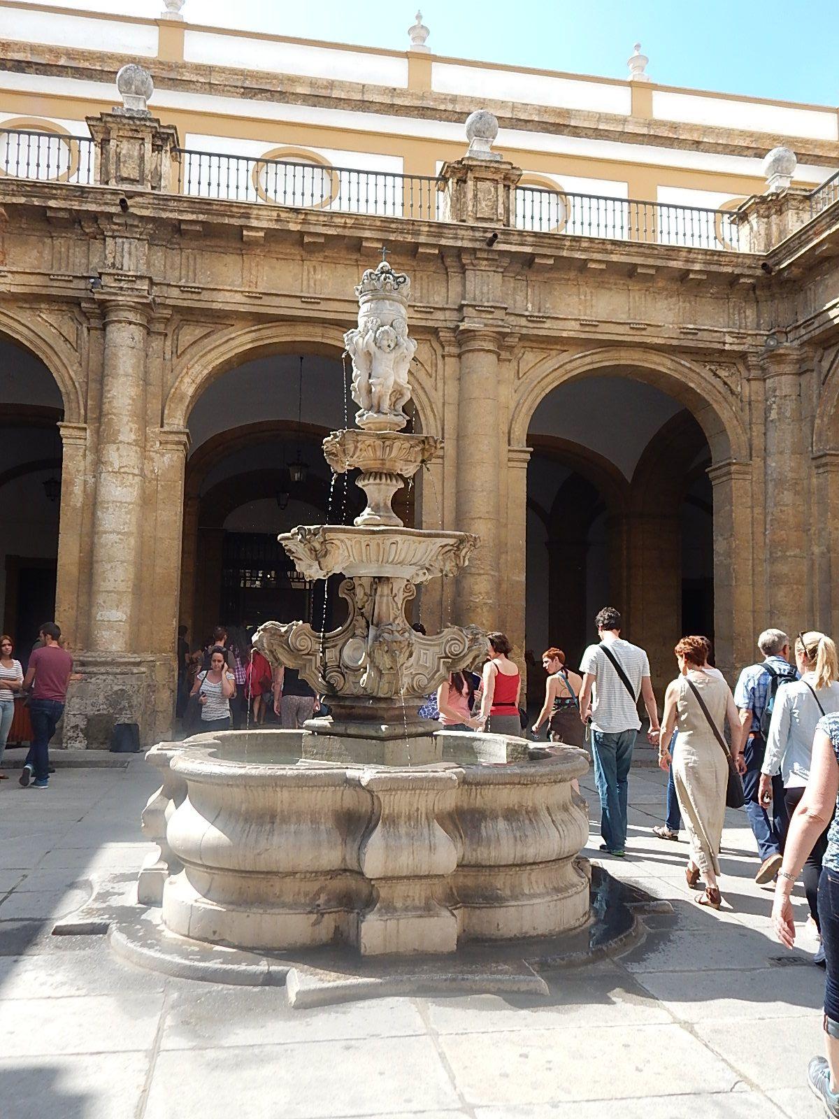 An ornate fountain in a Seville courtyard. Fountains