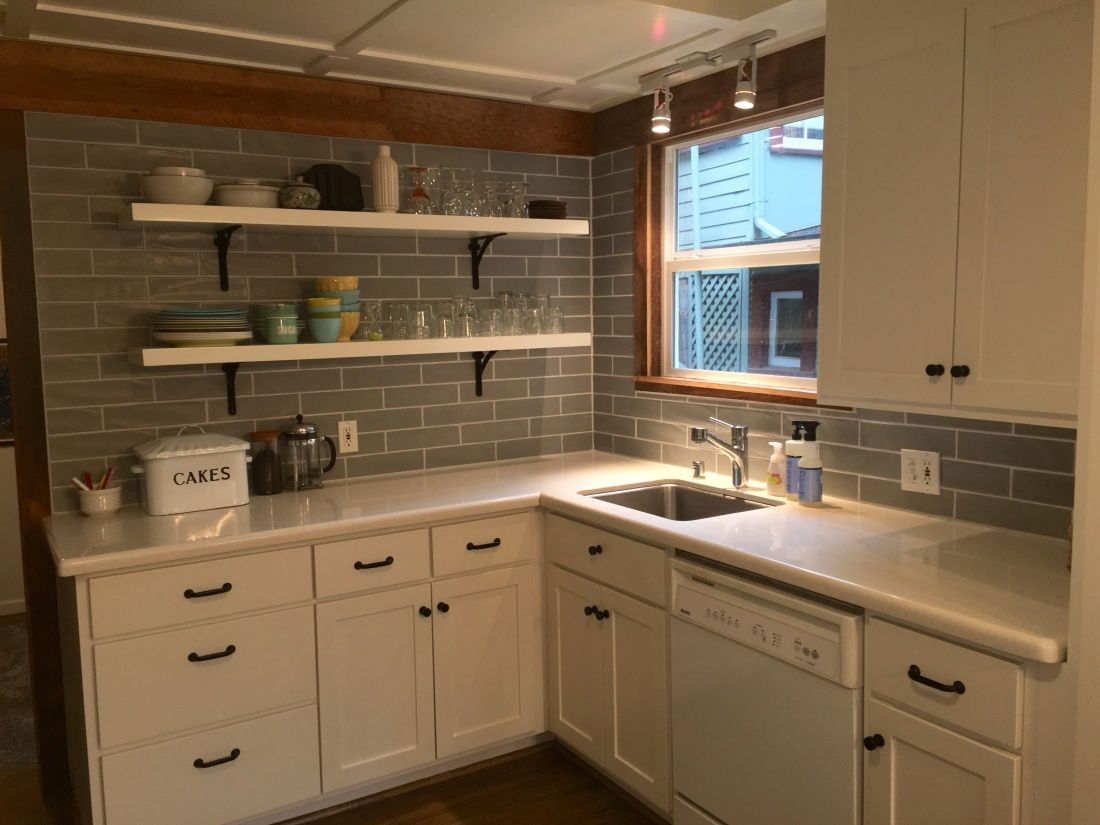 Gray subway tile wall with reclaimed wood trim and white open gray subway tile wall with reclaimed wood trim and white open shelves dailygadgetfo Images