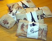 Muslin Ribbon Handstamped with Paris Themed Motif (12.5 yards total). $10.00, via Etsy.