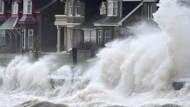 violent waves uk | Violent storm ... waves crash against a promenade wall in Prestwick ...