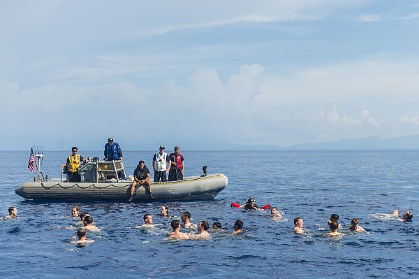 Sailors participate in a swim call from the amphibious transport dock ship USS Green Bay (LPD 20).