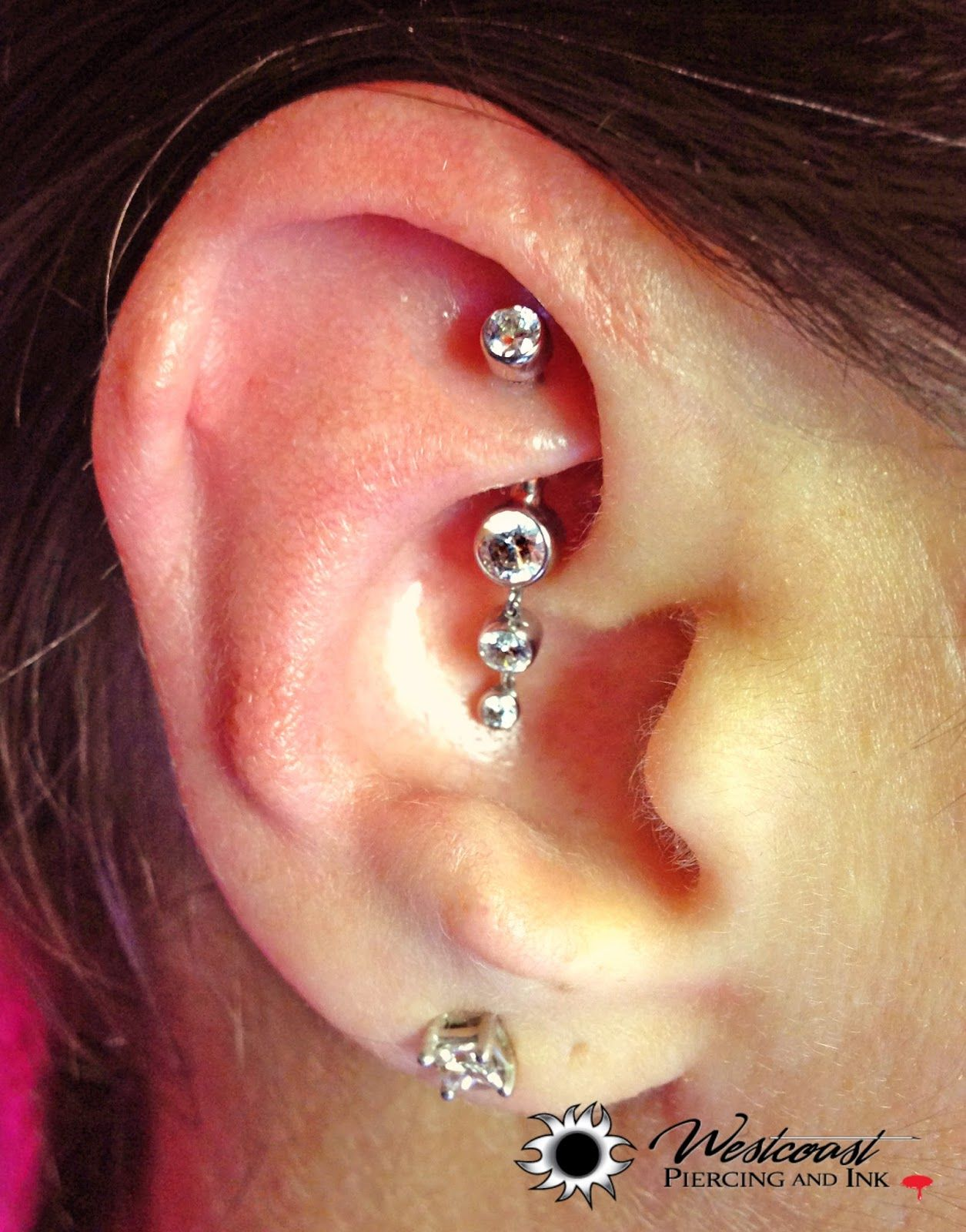 Extreme nose piercing  Custom made Beautiful triple dropper curved bar in her rook Another