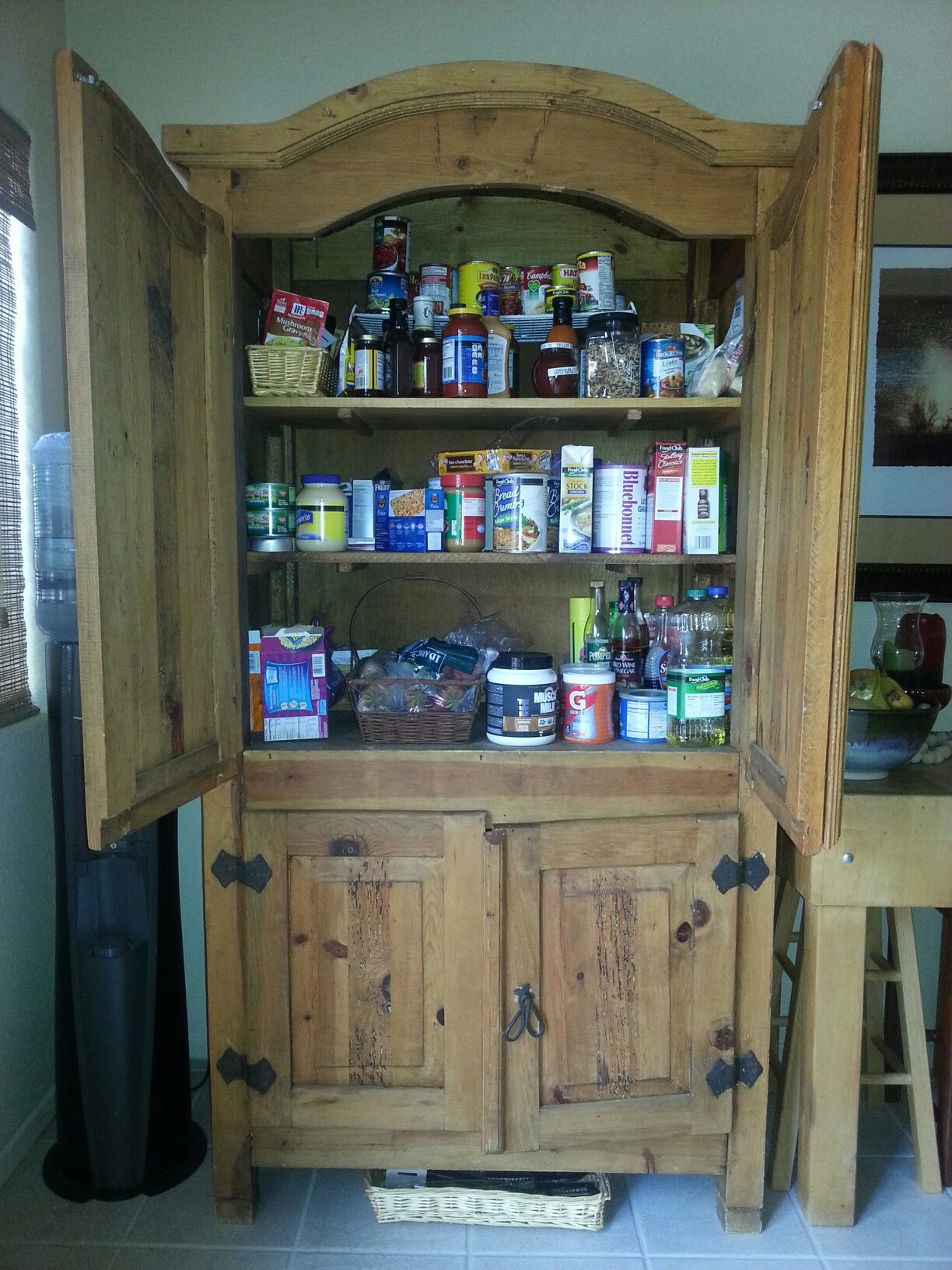 Armoire Turned To Kitchen Pantry For Food Storage