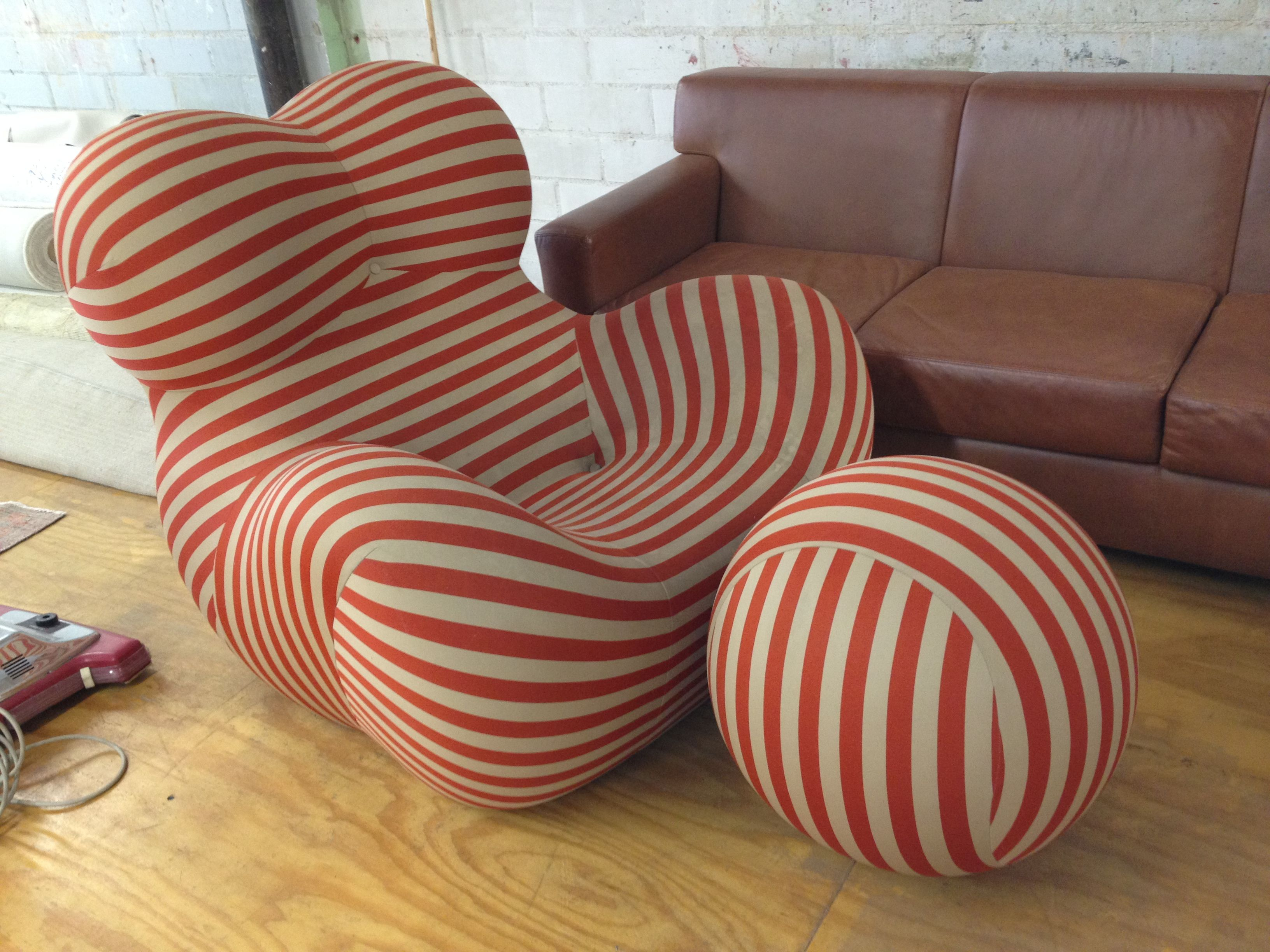 Curved modern red and white striped chair with matching ball