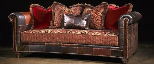 Delightful Finnegan Sofa Shown In Red With Genuine Leather Patchwork.