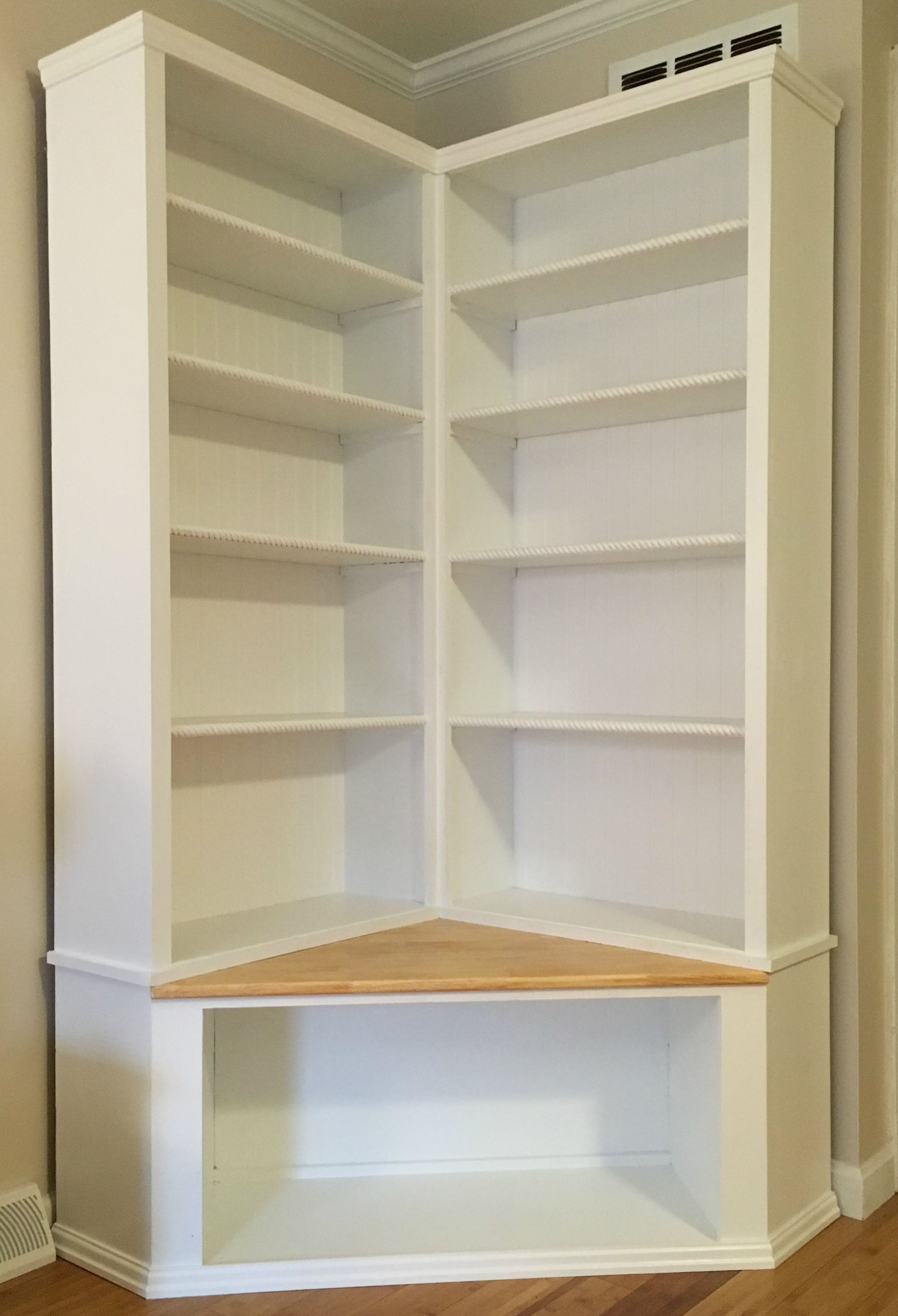 Custom made shabby chic corner bookcase with seat to Modern corner bookshelf