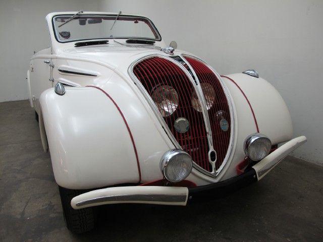 1938 Peugeot 402BL Eclipse Decapotable | Beverly Hills Car Club