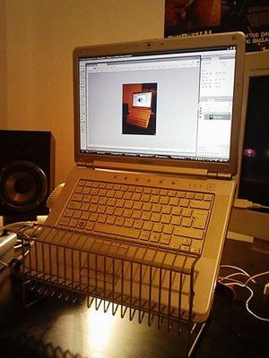 DIY Ikea Hack turns a CD rack into a laptop stand. This lifts the screen significantly and is intended to be used with a separate mouse and keyboard.