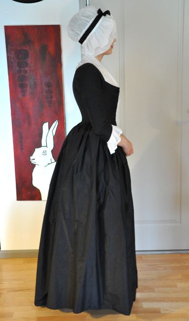 18th century. Love this black silk taffeta, open robe gown and cap with black silk ribbon.