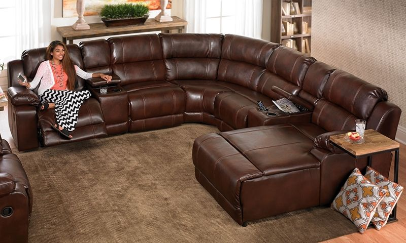 This Over Stuffed Sectional Sofa Features Built In Storage Consoles Cup Holders And A Chaise Lounge All Warm Chestnut Toned Bonded Leather