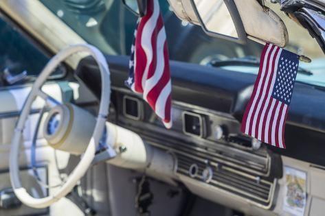 USA, Massachusetts, Cape Ann, Gloucester, classic cars, 1960's car interior with US flag Premium Photographic Print by Walter Bibikow | Art.com