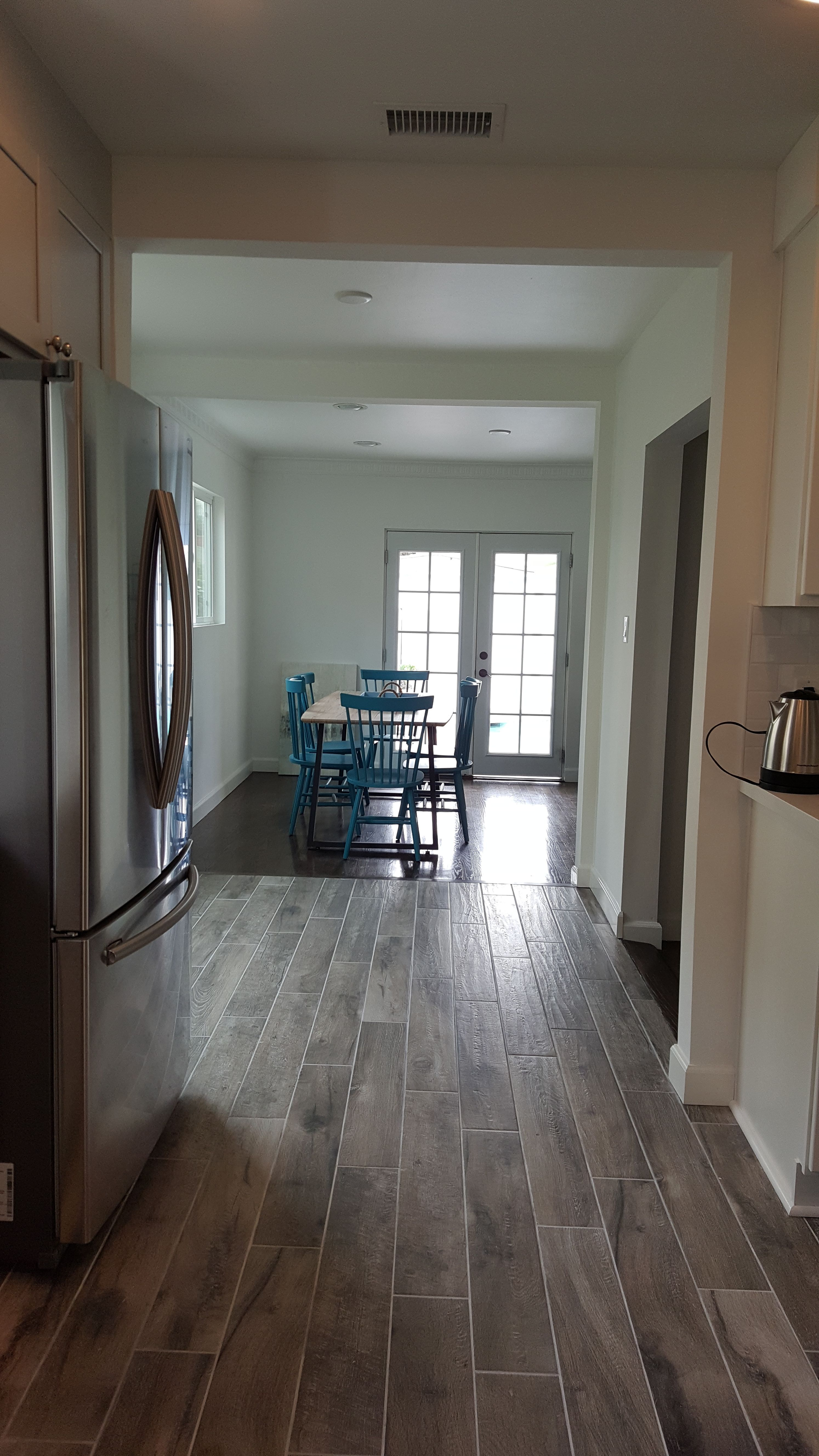 Porcelain tile planks that resemble wood flooring. Free in home consult and quote with LA remodeling contractor Joe Grimberg. 818-633-5462