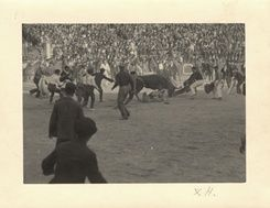 EH07891P  Ernest Hemingway fighting a bull, Pamplona, Spain, 1925.