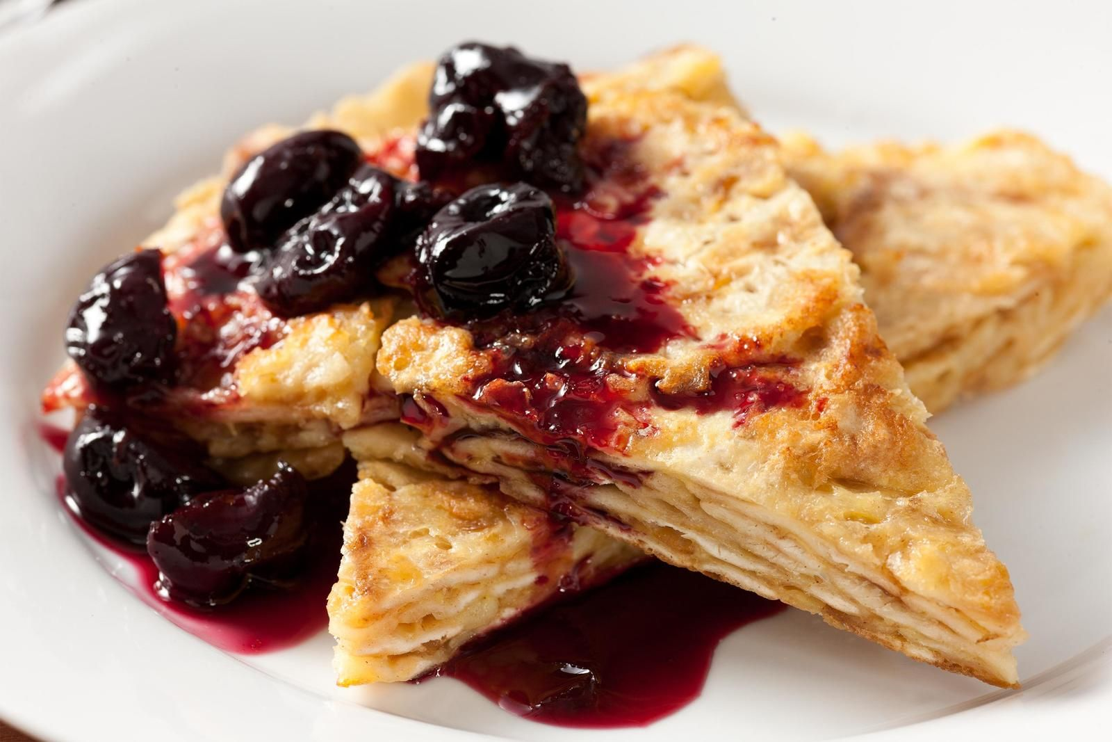 This breakfast recipe has eggy, buttery wedges of matzo brei covered in a sweet, syrupy topping of roasted cherries.